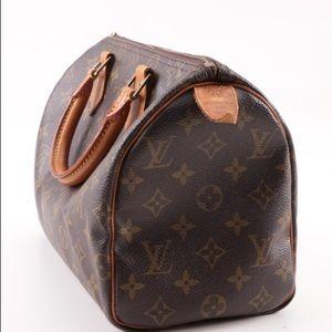 Louis Vuitton Paris Monogrammed Canvas Speedy Bag